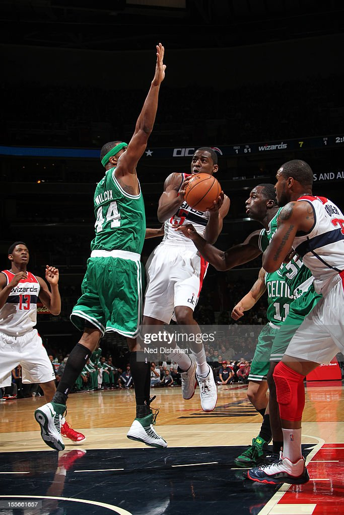 Jordan Crawford #15 of the Washington Wizards drives to the basket against Chris Wilcox #44 of the Boston Celtics at the Verizon Center on November 3, 2012 in Washington, DC.