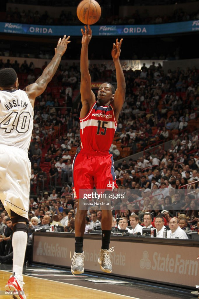 Jordan Crawford #15 of the Washington Wizards goes for a jump shot against Udonis Haslem #40 of the Miami Heat during a game between the Washington Wizards and the Miami Heat on December 15, 2012 at American Airlines Arena in Miami, Florida.