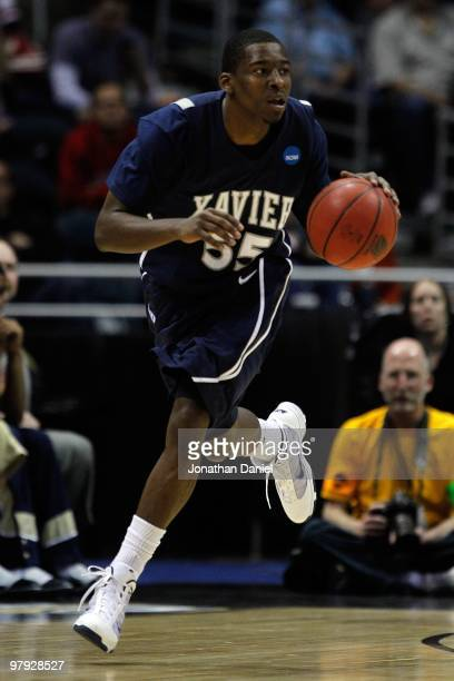 Jordan Crawford of the Xavier Musketeers moves the ball against against the Pittsburgh Panthers in the second half during the second round of the...