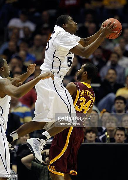 Jordan Crawford of the Xavier Musketeers shoots the ball over Damian Johnson of the Minnesota Golden Gophers during the first round of the 2010 NCAA...