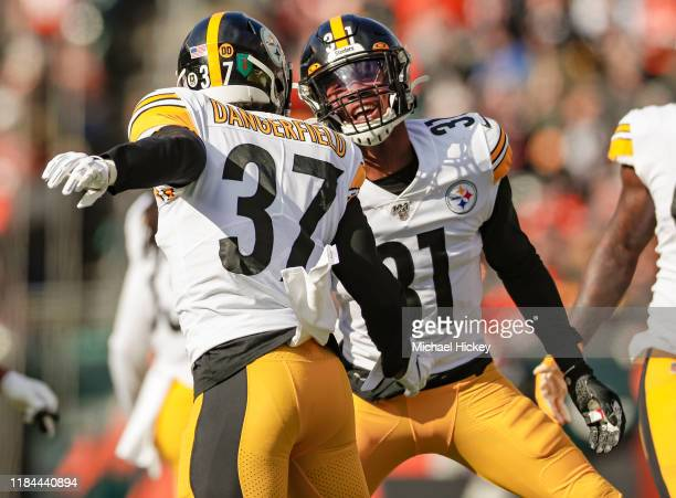 Jordan Dangerfield and Justin Layne of the Pittsburgh Steelers celebrate a defensive play during the first half against the Cincinnati Bengals at...
