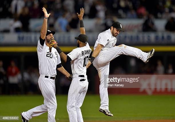 Jordan Danks Alexei Ramirez and Adam Eaton of the Chicago White Sox celebrate their win over the Kansas City Royals at US Cellular Field on September...