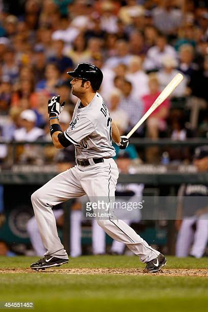 Jordan Danks of the Chicago White Sox bats during the game against the Seattle Mariners at Safeco Field on August 9 2014 in Seattle Washington The...