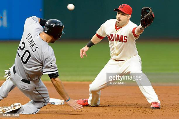 Jordan Danks of the Chicago White Sox is safe at second as second baseman Jason Kipnis of the Cleveland Indians catches a wide throw during the third...