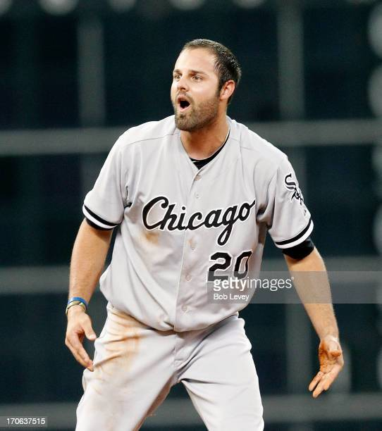 Jordan Danks of the Chicago White Sox looks at second base umpire Dana DeMuth after he was picked off to end the game against the Houston Astros at...