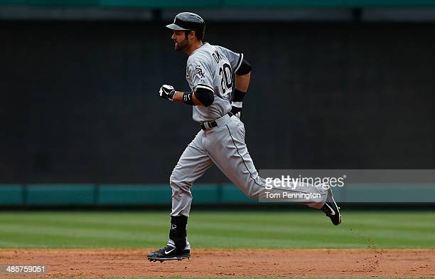 Jordan Danks of the Chicago White Sox rounds second base after hitting a two run home run against the Texas Rangers in the top of the third inning at...