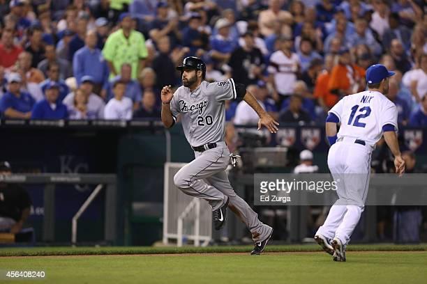 Jordan Danks of the Chicago White Sox runs home to score against the Kansas City Royals at Kauffman Stadium on September 17 2014 in Kansas City...