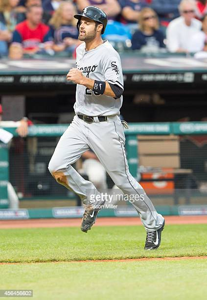 Jordan Danks of the Chicago White Sox scores on a hit by Adam Eaton during the third inning against the Cleveland Indians at Progressive Field on...
