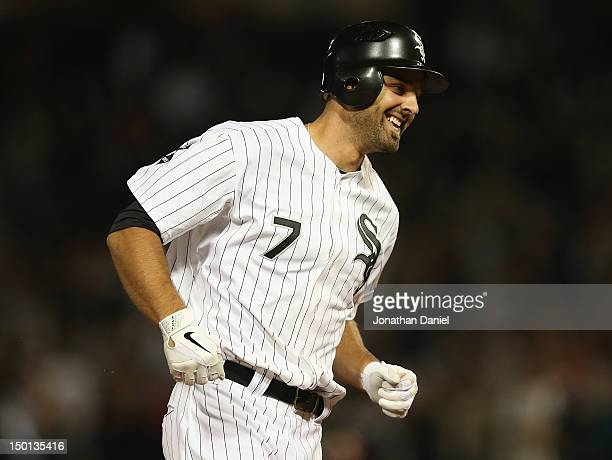 Jordan Danks of the Chicago White Sox smiles as he runs the bases after hitting a walkoff home run his first home run of the season to defeat the...