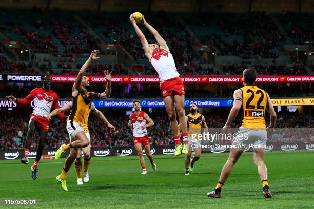 Jordan Dawson of the Swans marks during the round 14 AFL match between the Sydney Swans and the Hawthorn Hawks at Sydney Cricket Ground on June 21,...