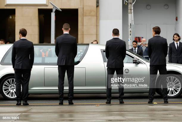 Jordan De Goey and Levi Greenwood of the Magpies look on as current magpies players form a guard of honour as the procession travels down during the...