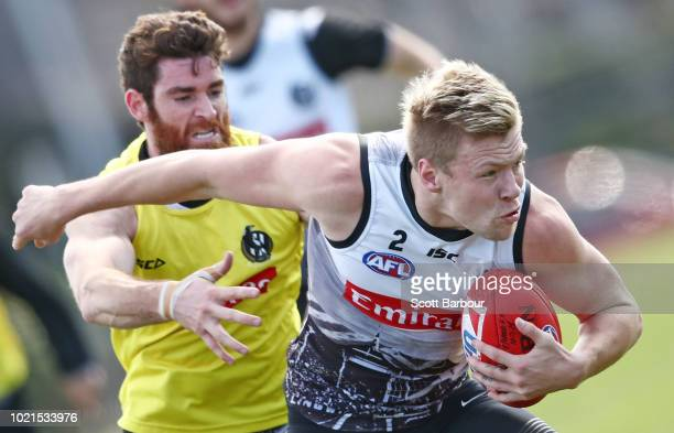 Jordan De Goey of the Magpies is tackled by Tyson Goldsack of the Magpies during a Collingwood Magpies AFL training session at the Holden Centre on...