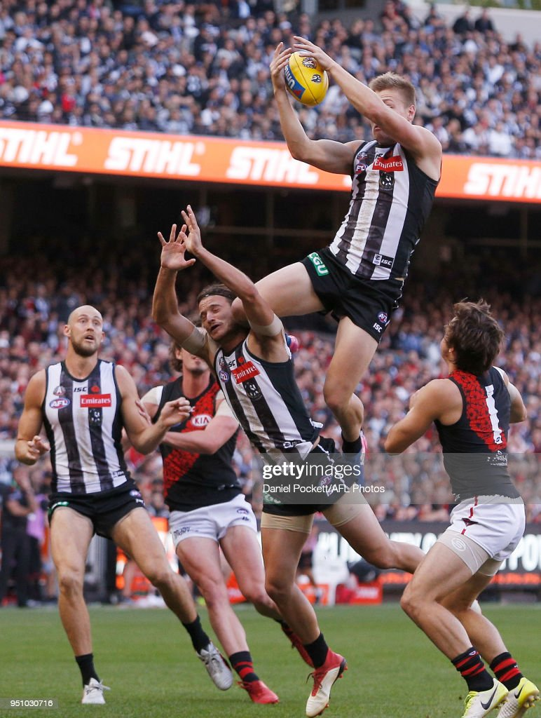 Jordan De Goey of the Magpies marks the ball during the round five AFL match between the Collingwood Magpies and the Essendon Bombers at Melbourne Cricket Ground on April 25, 2018 in Melbourne, Australia.