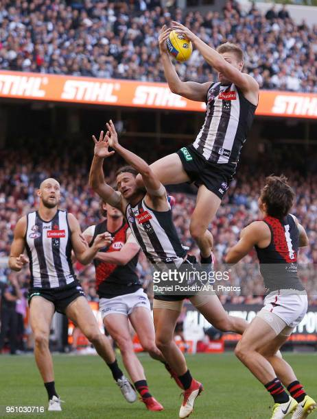 Jordan De Goey of the Magpies marks the ball during the round five AFL match between the Collingwood Magpies and the Essendon Bombers at Melbourne...