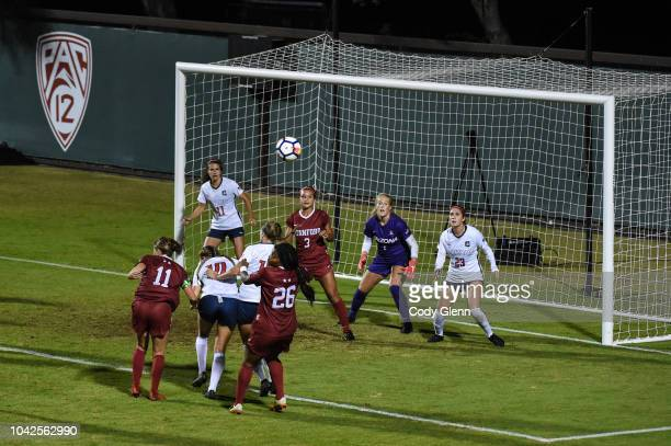 Jordan DiBiasi of Stanford heads the ball wide of goal from a corner kick against University in action against yyy # of University of Arizona at...