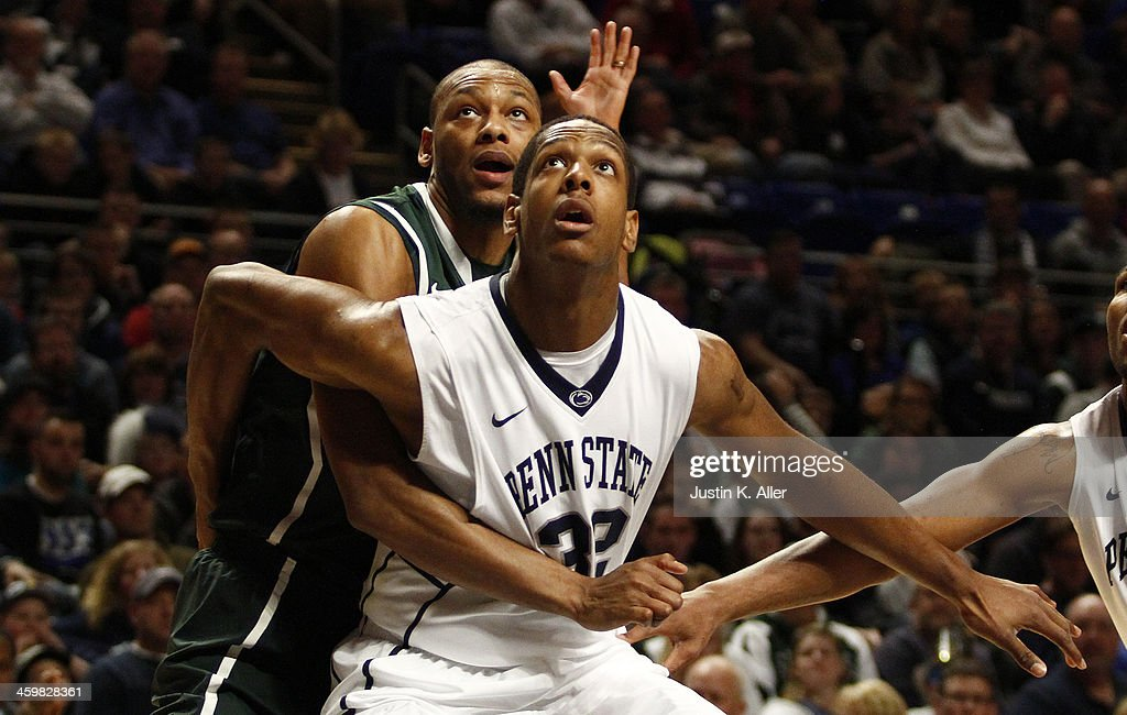 Jordan Dickerson #32 of the Penn State Nittany Lions and Adreian Payne #5 of the Michigan State Spartans battle for a rebound at the Bryce Jordan Center on December 31, 2013 in State College, Pennsylvania.