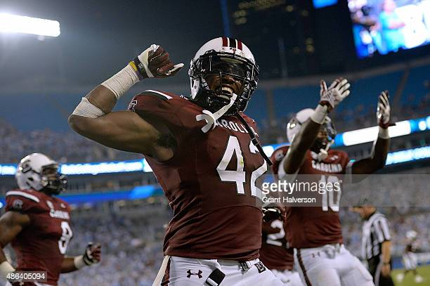 Jordan Diggs and Skai Moore of the South Carolina Gamecocks celebrate during a win against the North Carolina Tar Heels at Bank of America Stadium on...
