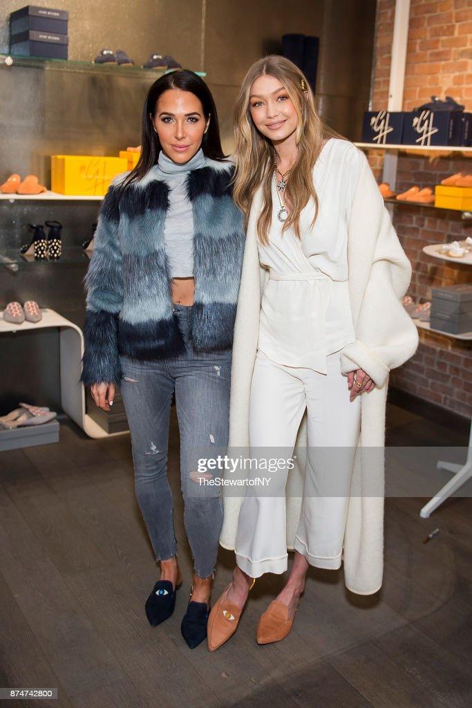 Jordan Duffy (L) and Gigi Hadid attend the Stuart Weitzman Pop-Up Event at Stuart Weitzman Boutique on November 15, 2017 in New York City.