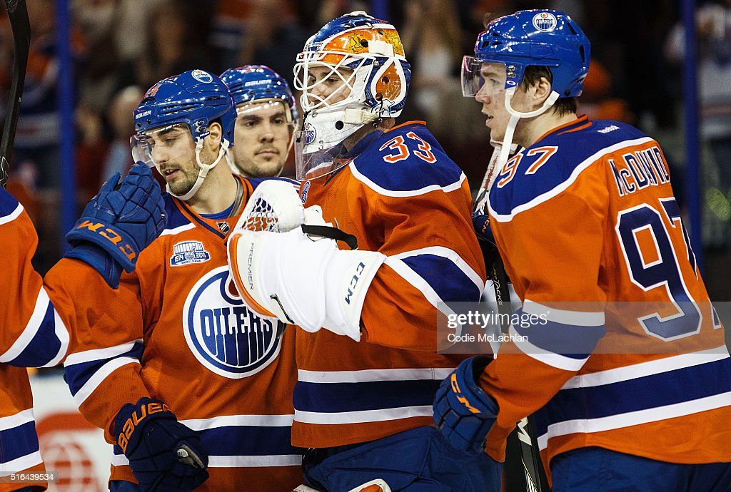 Jordan Eberle #14, Adam Clendening #27, goaltender Cam Talbot #33 and Connor McDavid #97 of the Edmonton Oilers celebrate their victory against the Vancouver Canucks on March 18, 2016 at Rexall Place in Edmonton, Alberta, Canada.