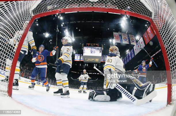 Jordan Eberle and Anders Lee of the New York Islanders celebrate a first period goal by Jordan Eberle against Carter Hutton of the Buffalo Sabres at...