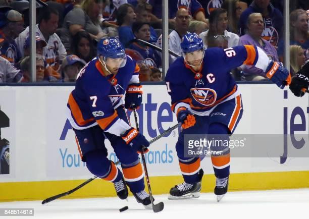 Jordan Eberle and John Tavares of the New York Islanders skates against the Philadelphia Flyers during a preseason game at the Nassau Veterans...