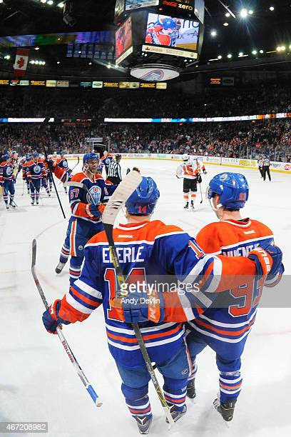 Jordan Eberle and Ryan NugentHopkins of the Edmonton Oilers celebrate after winning the game against the Philadelphia Flyers on March 21 2015 at...