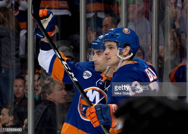 Jordan Eberle is congratulated by his teammate Mathew Barzal of the New York Islanders after scoring a first period goal against the Arizona Coyotes...