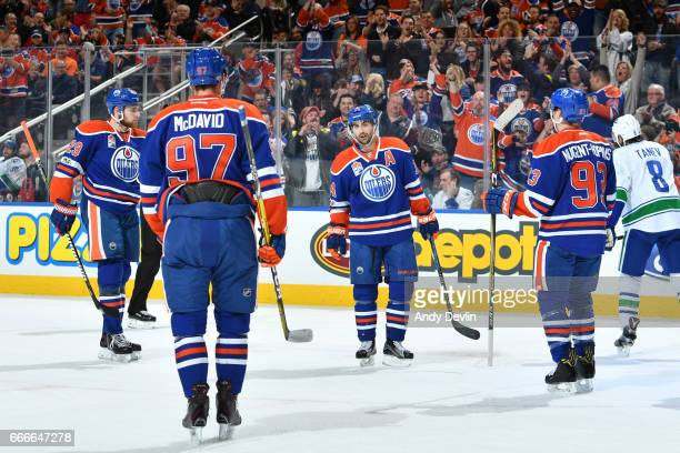 Jordan Eberle Leon Draisaitl Ryan NugentHopkins and Connor McDavid of the Edmonton Oilers celebrate after a goal during the game against the...