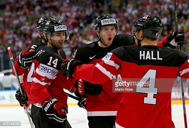 Jordan Eberle of Canada celebrate with his teammates after he scores his team's opening goal during the IIHF World Championship group A match between...