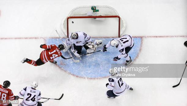 Jordan Eberle of Team Canada scores against Thomas McCollum of Team USA as team mates Jimmy Hayes and Ryan McDonagh of Team USA look on during the...