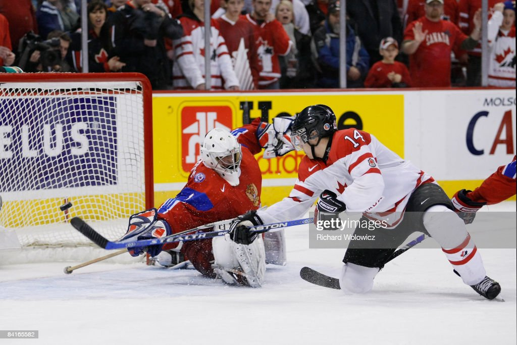 Jordan Eberle #14 of Team Canada scores the tying goal to force overtime on Vadim Zhelobnyuk #1 of Team Russia during the semifinals at the IIHF World Junior Championships at the Ottawa Civic Centre on January 03, 2009 in Ottawa, Ontario, Canada. Team Canada defeated Team Russia 6-5 in a shootout.