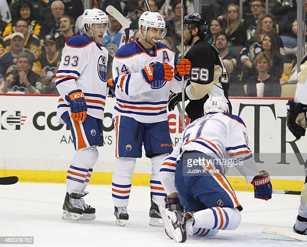 Jordan Eberle of the Edmonton Oilers celebrates with Anton Lander after scoring in the second period during the game against the Pittsburgh Penguins...