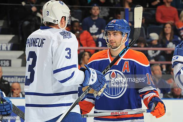 Jordan Eberle of the Edmonton Oilers exchanges words with Dion Phaneuf of the Toronto Maple Leafs on March 16 2015 at Rexall Place in Edmonton...