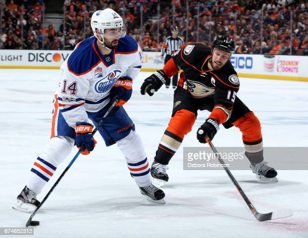Jordan Eberle of the Edmonton Oilers handles the puck against Ryan Getzlaf of the Anaheim Ducks in Game Two of the Western Conference Second Round...