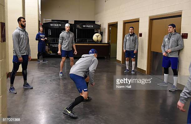 Jordan Eberle of the Edmonton Oilers heads a soccer ball as teammates Darnell Nurse Laurent Brossoit Anton Lander and Leon Draisaitl look on as they...