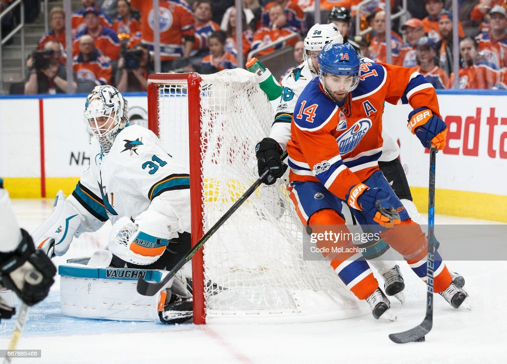 Jordan Eberle #14 of the Edmonton Oilers is pursued by Melker Karlsson #68 of the San Jose Sharks in Game One of the Western Conference First Round during the 2017 NHL Stanley Cup Playoffs at Rogers Place on April 12, 2017 in Edmonton, Alberta, Canada.