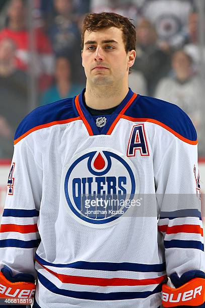 Jordan Eberle of the Edmonton Oilers looks on during the singing of 'O Canada' prior to puck drop against the Winnipeg Jets at the MTS Centre on...