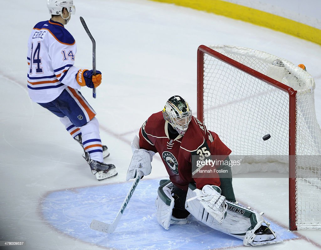 Jordan Eberle #14 of the Edmonton Oilers scores a goal against Darcy Kuemper #35 of the Minnesota Wild during the shootout of the game on March 11, 2014 at Xcel Energy Center in St. Paul, Minnesota. The Oilers defeated the Wild 4-3 in a shootout.