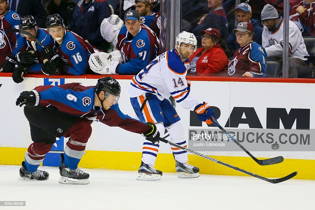 Jordan Eberle #14 of the Edmonton Oilers scores an empty net goal past an outstretched Erik Johnson #6 of the Colorado Avalanche during the third period at Pepsi Center on November 23, 2016 in Denver, Colorado. The Oilers defeated the Avalanche 6-3.