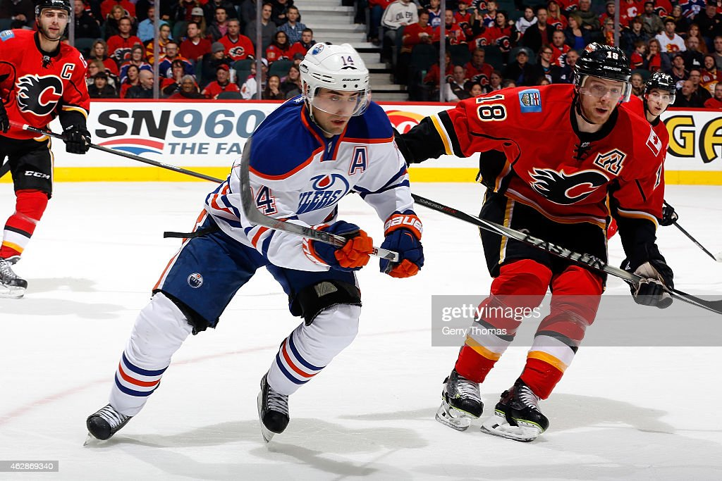 Jordan Eberle #14 of the Edmonton Oilers skates against the Calgary Flames at Scotiabank Saddledome on January 31, 2015 in Calgary, Alberta, Canada. The Flames won 4-2.