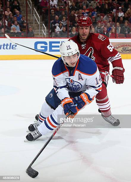 Jordan Eberle of the Edmonton Oilers skates with the puck during the NHL game against the Phoenix Coyotes at Jobing.com Arena on April 4, 2014 in...