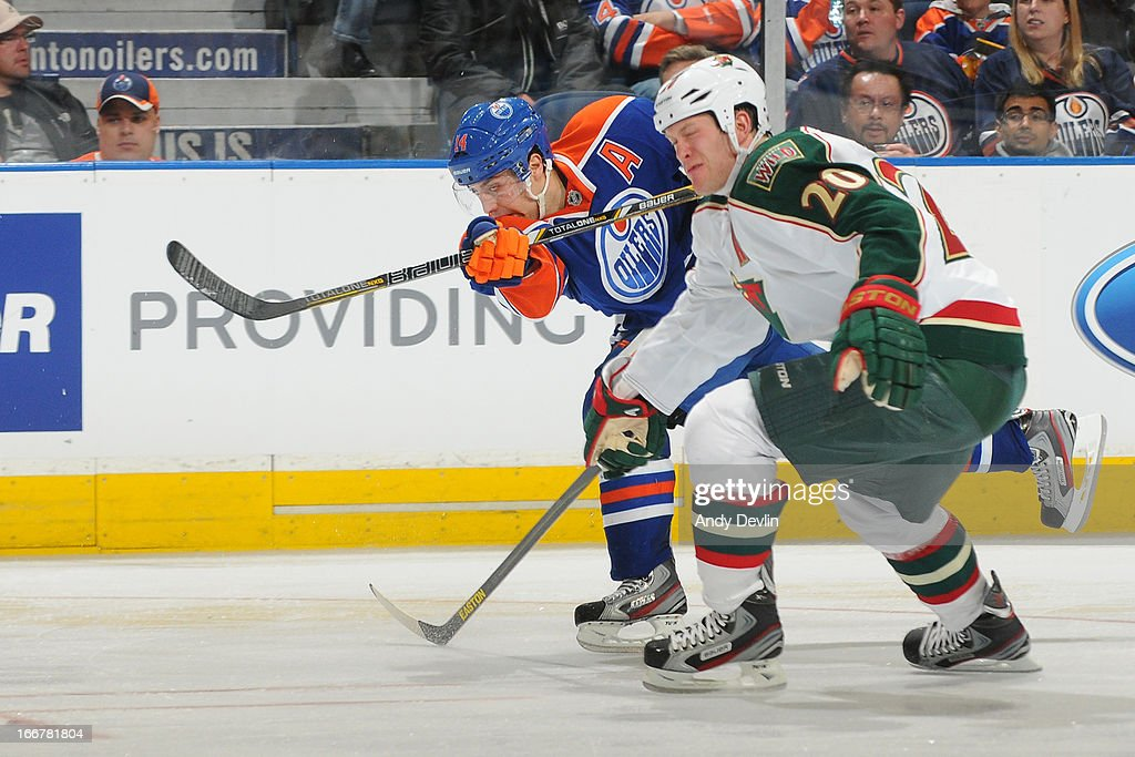 Jordan Eberle #14 of the Edmonton Oilers takes a shot as Ryan Suter #20 of the Minnesota Wild attempts to block it on April 16, 2013 at Rexall Place in Edmonton, Alberta, Canada.