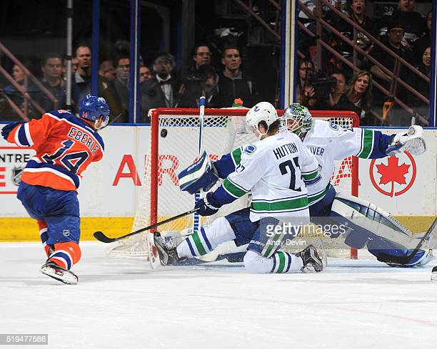 Jordan Eberle of the Edmonton Oilers takes a shot on Jacob Markstrom of the Vancouver Canucks on April 6 2016 at Rexall Place in Edmonton Alberta...