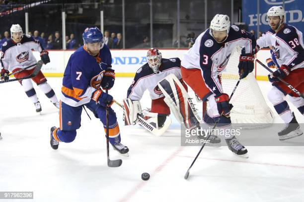 Jordan Eberle of the New York Islanders and Seth Jones of the Columbus Blue Jackets chase after the puck in the second period during their game at...