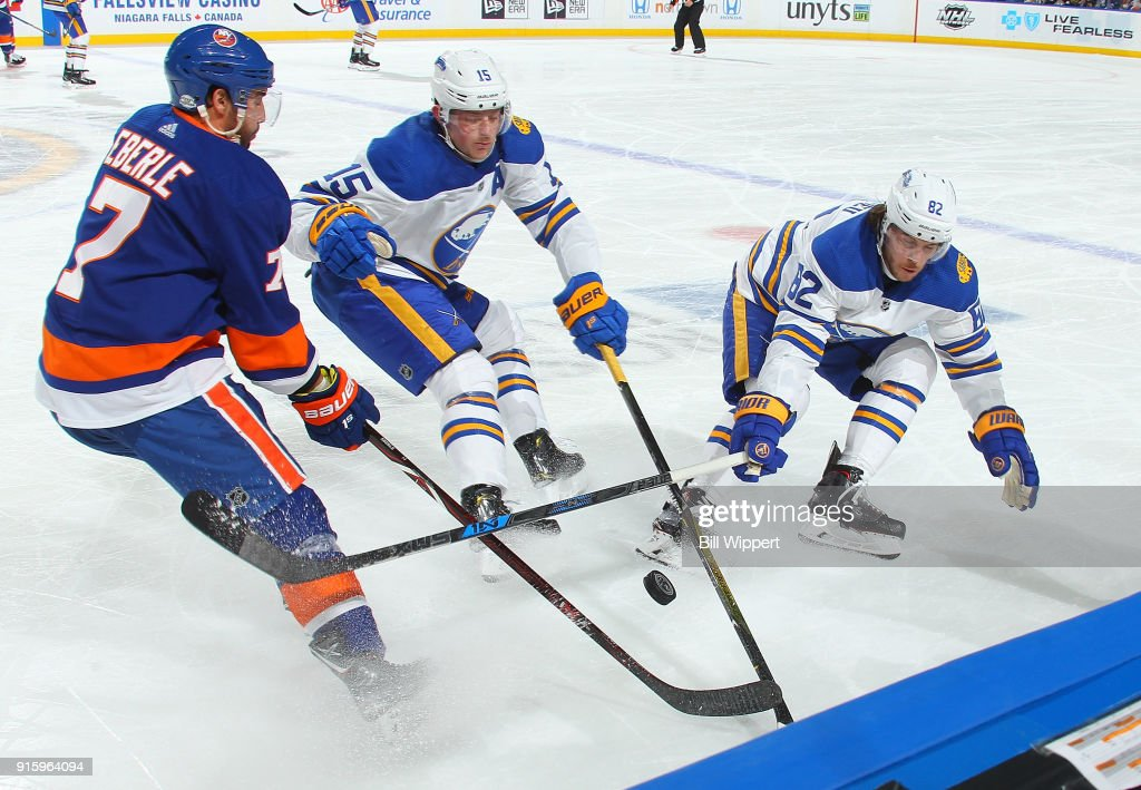 Jordan Eberle #7 of the New York Islanders battles for the puck against Jack Eichel #15 and Nathan Beaulieu #82 of the Buffalo Sabres during an NHL game on February 8, 2018 at KeyBank Center in Buffalo, New York. Buffalo won, 4-3.