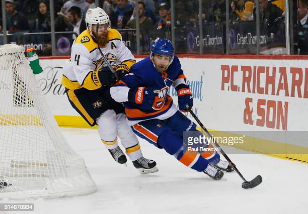 Jordan Eberle of the New York Islanders carries the puck as Ryan Ellis of the Nashville Predators gives chase during the first period on February 5...