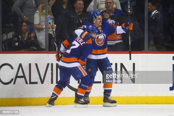 Jordan Eberle of the New York Islanders celebrates his gamewinning goal in overtime with Mathew Barzal against the Los Angeles Kings at Barclays...