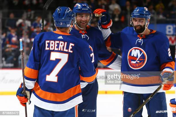 Jordan Eberle of the New York Islanders celebrates his second goal of the game against Colorado Avalanche with teammates Johnny Boychuk and Nick...