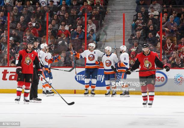 Jordan Eberle of the New York Islanders celebrates his third period goal with teammates including Andrew Ladd and Nick Leddy as Erik Karlsson and...