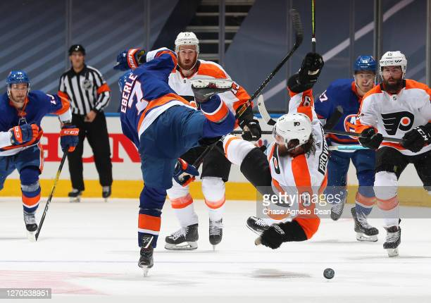 Jordan Eberle of the New York Islanders checks Ivan Provorov of the Philadelphia Flyers in the first overtime period of Game Six of the Eastern...